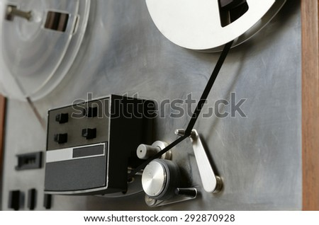 steel spindle reel to reel tape recorder  - stock photo