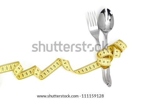 Steel spoon a fork and measuring tape isolated - stock photo