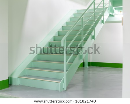 Steel stair in white room. - stock photo