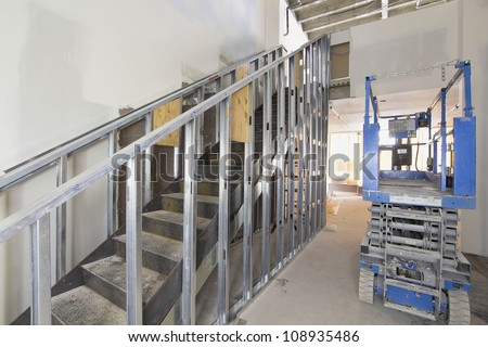 Steel Staircase Construction In Commercial Space With Metal Studs Support
