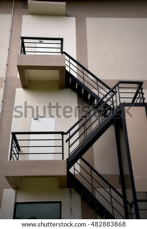 Steel steps at modern building fire exit, exterior architecture design