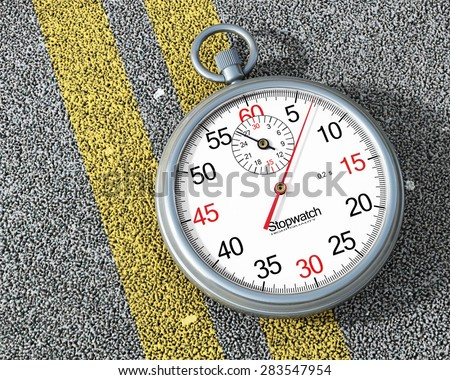 Steel stopwatch on the road. Fast concept. - stock photo