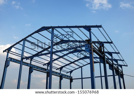Steel structure of a new industrial building - stock photo