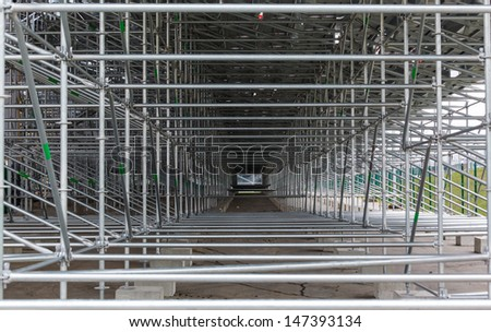 steel structure of construction scaffolding - stock photo