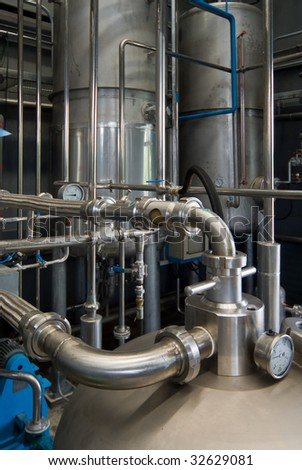 Steel tanks and pipes at industrial processing plant. - stock photo