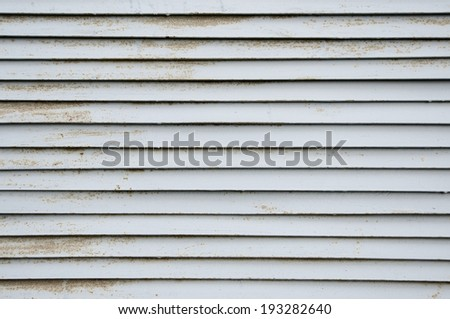 steel ventilation grille on the wall of a building - stock photo