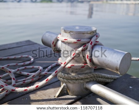 steel wharf on wooden dock - stock photo