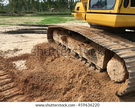 Digging car stock photos royalty free images vectors for Soil yellow color