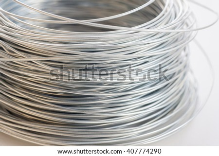 Steel wire for knitting metal rods bars into framework reinforcement. Selective focus - stock photo