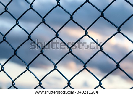 Steel Wire mesh and cloud  in Evening Sky background - stock photo