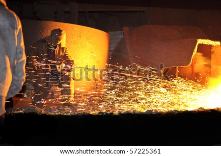 steelmaker burns oxygen opening for producing of cast-iron from a high furnace - stock photo