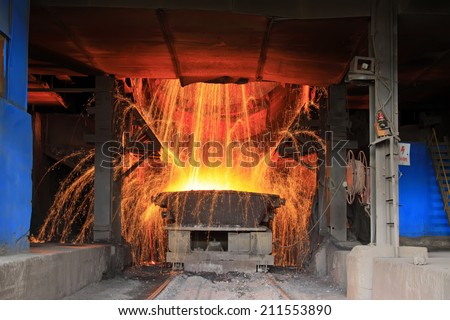 steelmaking converter dumping steel slag in a factory, closeup of photo