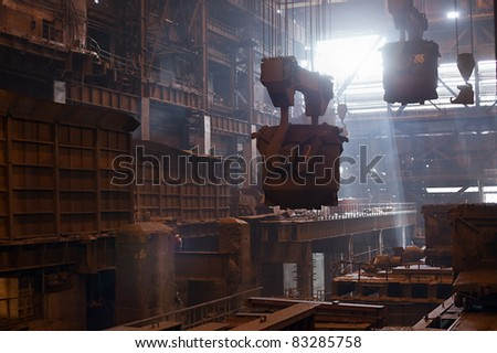 Steelmaking ladles hanging on crane on iron metallurgy mill - stock photo
