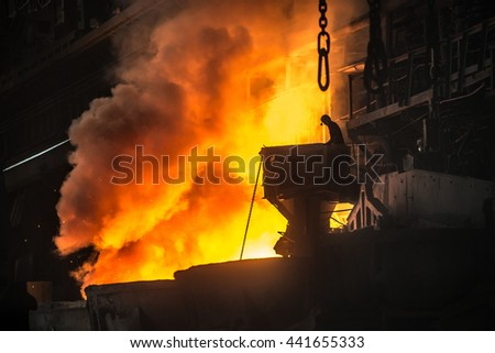 Steelworker near the tanks with hot metal