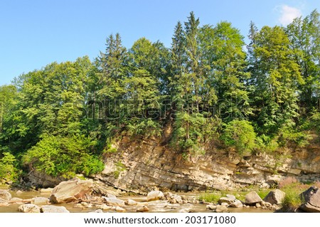 Steep bank of the Dniester River, Carpathians Ukraine - stock photo