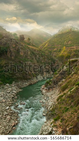 steep canyons of the mountain river in the Himalayas. Alaknanda river, Uttarakhand, India - stock photo