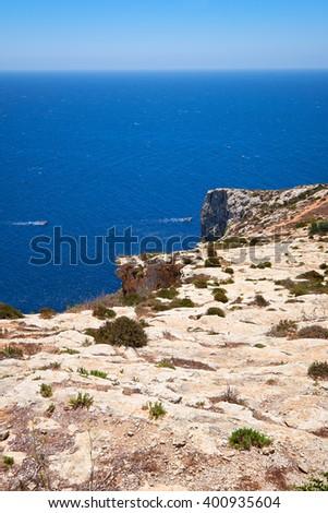 Steep cliff over Mediterranean sea on south part of Malta island near Blue Grotto - stock photo