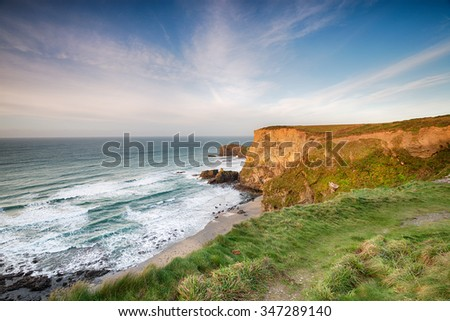 Steep cliffs at Basset's Cove near Portreath on the Cornish coast - stock photo