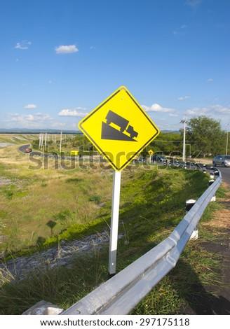 Steep grade hill ahead warning road sign - stock photo