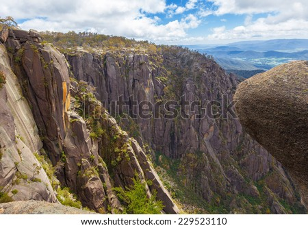 Steep high cliffs and boulders at Mt. Buffalo National Park, Victoria, Australia - stock photo