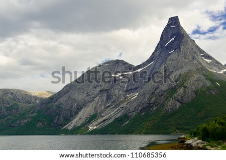 Steep peak in northern Norway with the fjord at the bottom