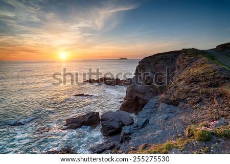 Steep rugged cliffs at Longcarrow Cove on the north coast of Cornwall - stock photo