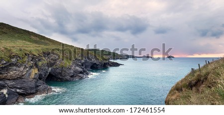 Steep rugged cliffs, sea caves and high waves at Epphaven between Lundy Bay and Port Quin in Cornwall