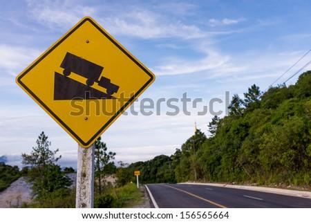 Steep slope road traffic sign on Doi Intanon road,Thailand - stock photo