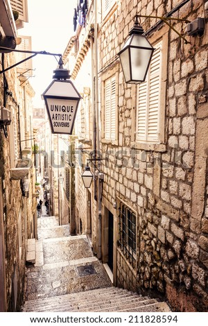 Steep stairs and narrow street in old town of Dubrovnik - stock photo