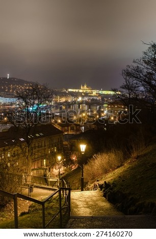 steep stairway leading to the vysehrad castle with prague panorama and the prague castle behind it. - stock photo