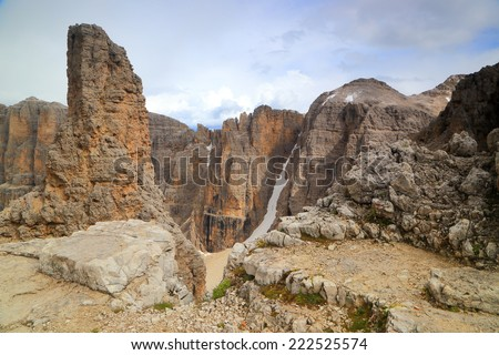 Steep towers of Sella massif under the clouds, Dolomite Alps, Italy