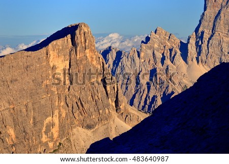 Steep walls of the Dolomite Alps at sunset, Italy