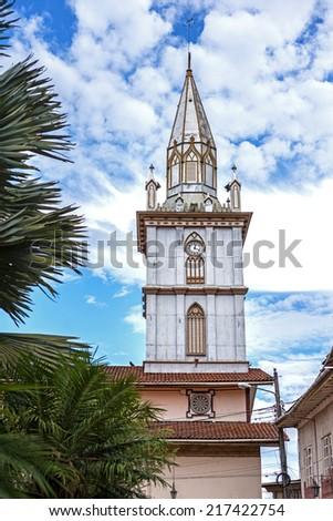 Steeple of an old cathedral on a sunny day, Zaruma, Ecuador - stock photo