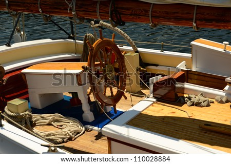 Steering rudder section of a large two masted sailing schooner with new teak decks - stock photo