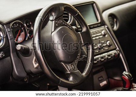 Steering wheel and dashboard in interior of the sports car