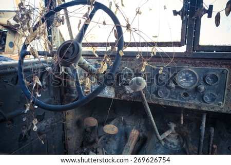 steering wheel and dashboard of old rusty car