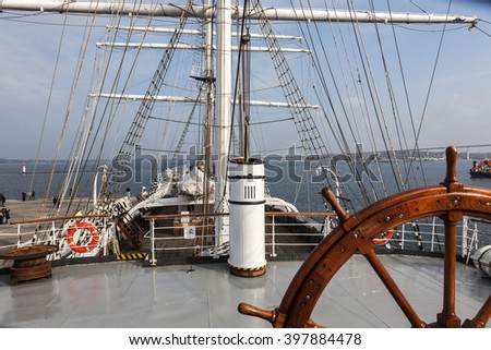 steering wheel and deck of a tall ship Gorch Fock - stock photo