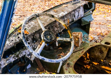 Steering wheel detail of an old abandoned truck