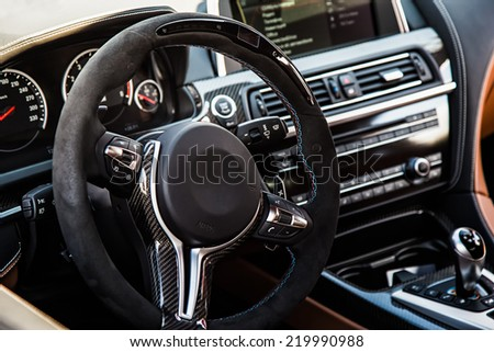 Steering wheel in interior of the sports car