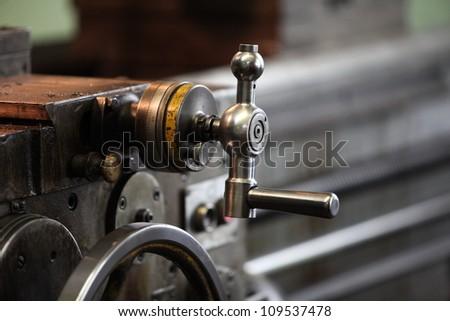 steering wheel is very old lathe, closeup - stock photo
