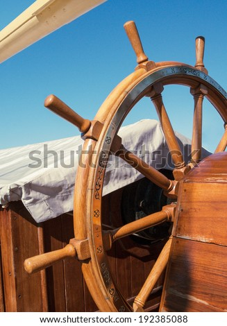 Steering wheel - nautical equipment on the old tall ship. Ship's deck exterior with tackles and marine equipment. Skipper control bridge with captains wheel of the old vessel. - stock photo
