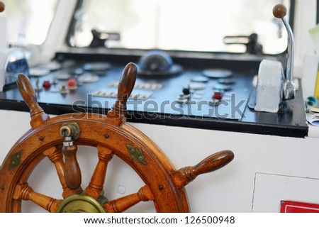 Steering wheel of a sailboat - stock photo