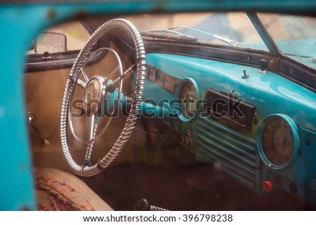 Steering wheel of old abandoned car - stock photo