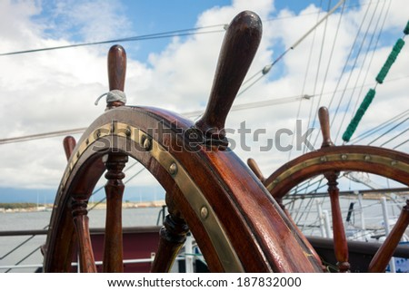 Steering wheel of the ship - stock photo