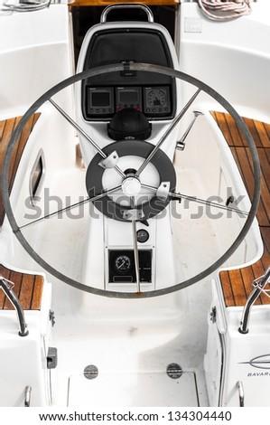 Steering wheel on a luxury yacht closeup - stock photo