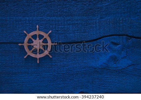steering wheel on an old blue wooden background. empty space for inscription - stock photo