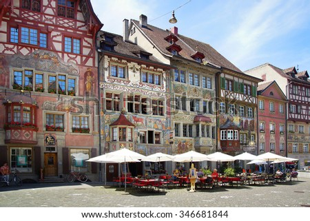 STEIN AM RHEIN, SWITZERLAND- JUNE 12, 2015: Medieval town centre. The old portion of the city has many fine Renaissance era buildings decorated with exterior frescos and sculpture.  - stock photo