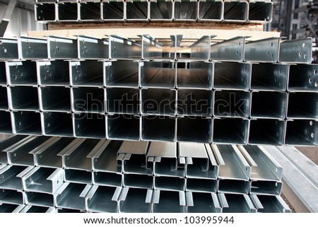 Stell zinc coated profiles in the rack - stock photo