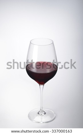 Stem Glass of Red Wine on white plane