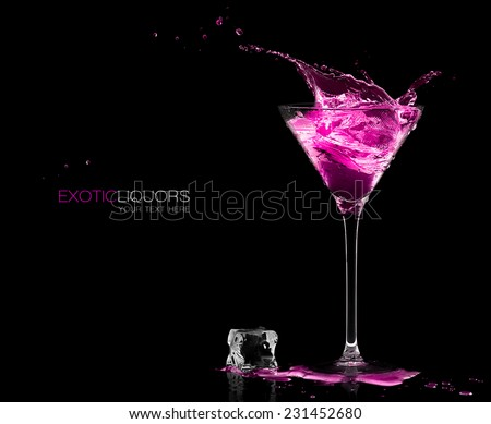 Stemmed cocktail glass with strawberry liquor splashing out, close-up isolated on black. Template design with sample text